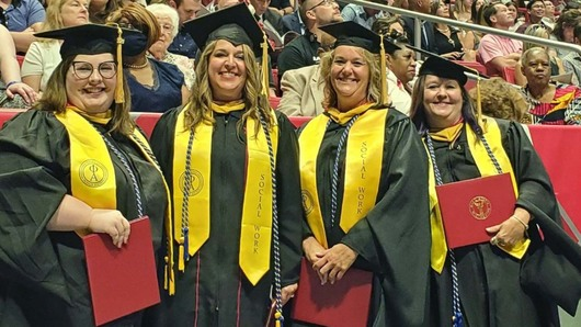 Master's graduates pose for picture