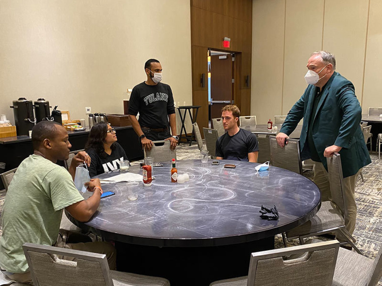 President Michael Fitts (right) and Senior Vice President and Dean of Admission for Enrollment Management and Graduate and Pre-college Strategy Satyajit Dattagupta (middle) talk with Tulane students who were evacuated to Houston.