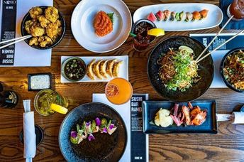 Colorful drinks and plates of food on a table
