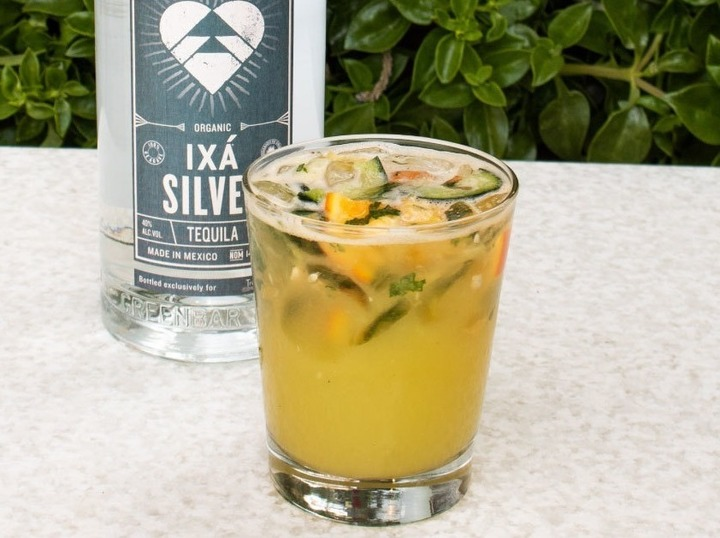 Citrus Margarita and bottle of silver tequila