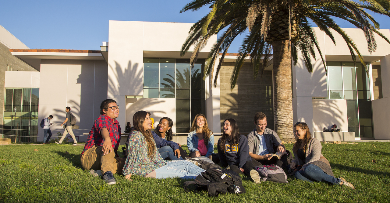 Students gathered on the UCSB Library lawn talking and laughing
