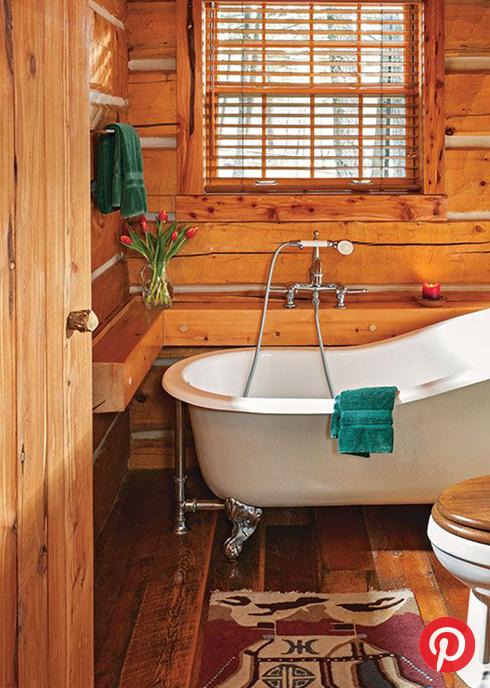 A wood-paneled cabin bathroom