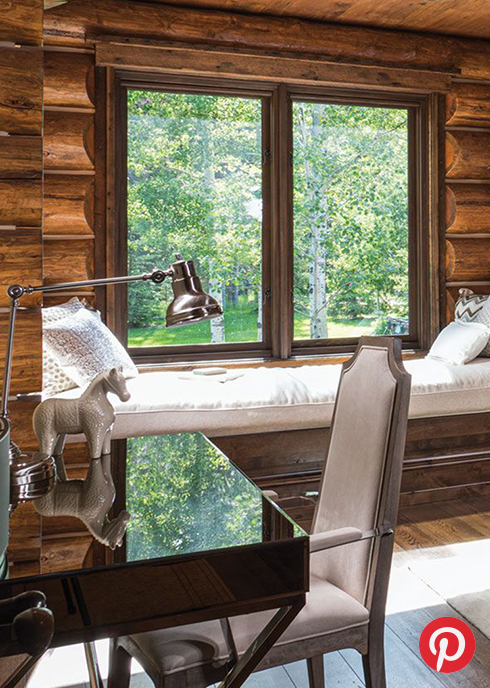 A desk and window seat in a cabin