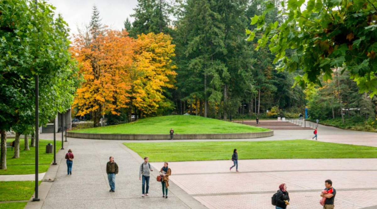 a picture looking out on McCann Plaza showing students walking and fall colored trees in the background.
