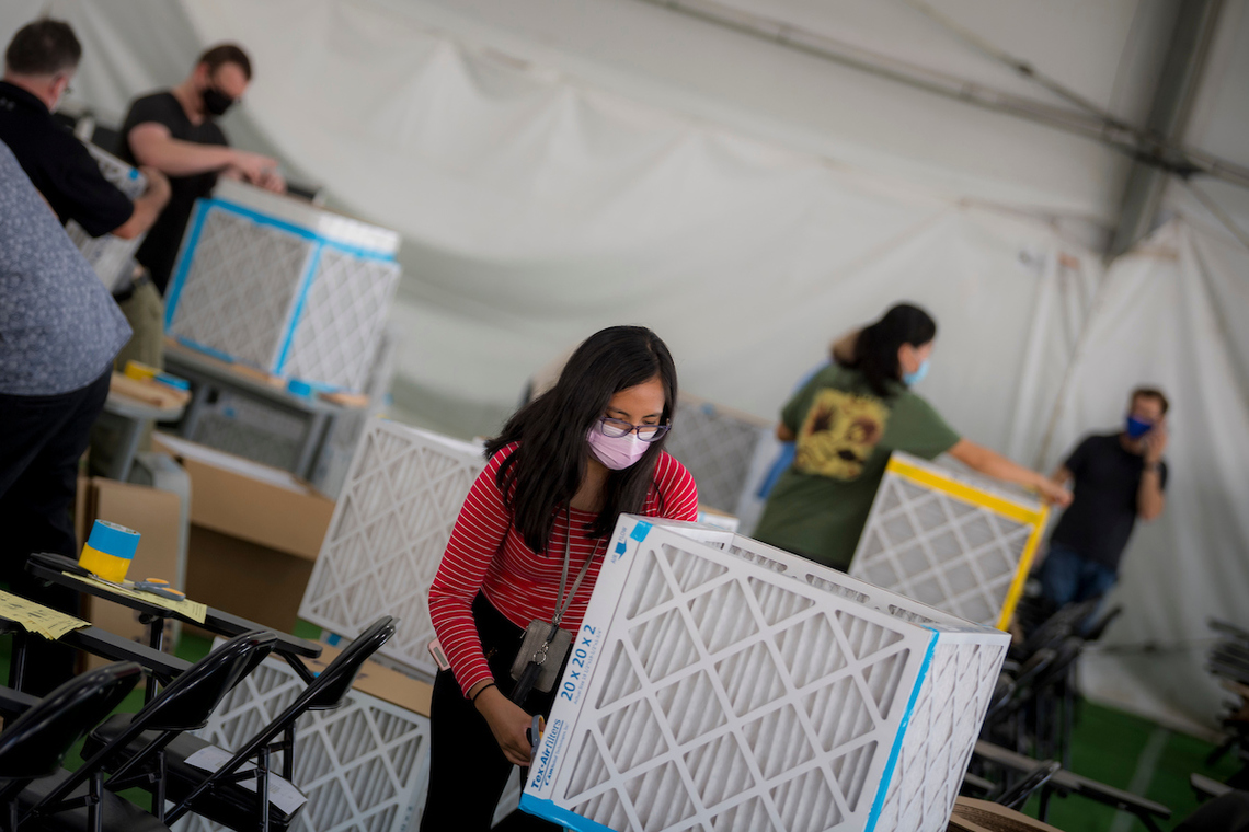UC San Diego student creating an air filtration system to use in classrooms.