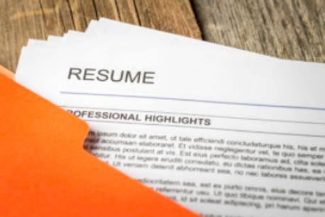 a resume in an orange folder