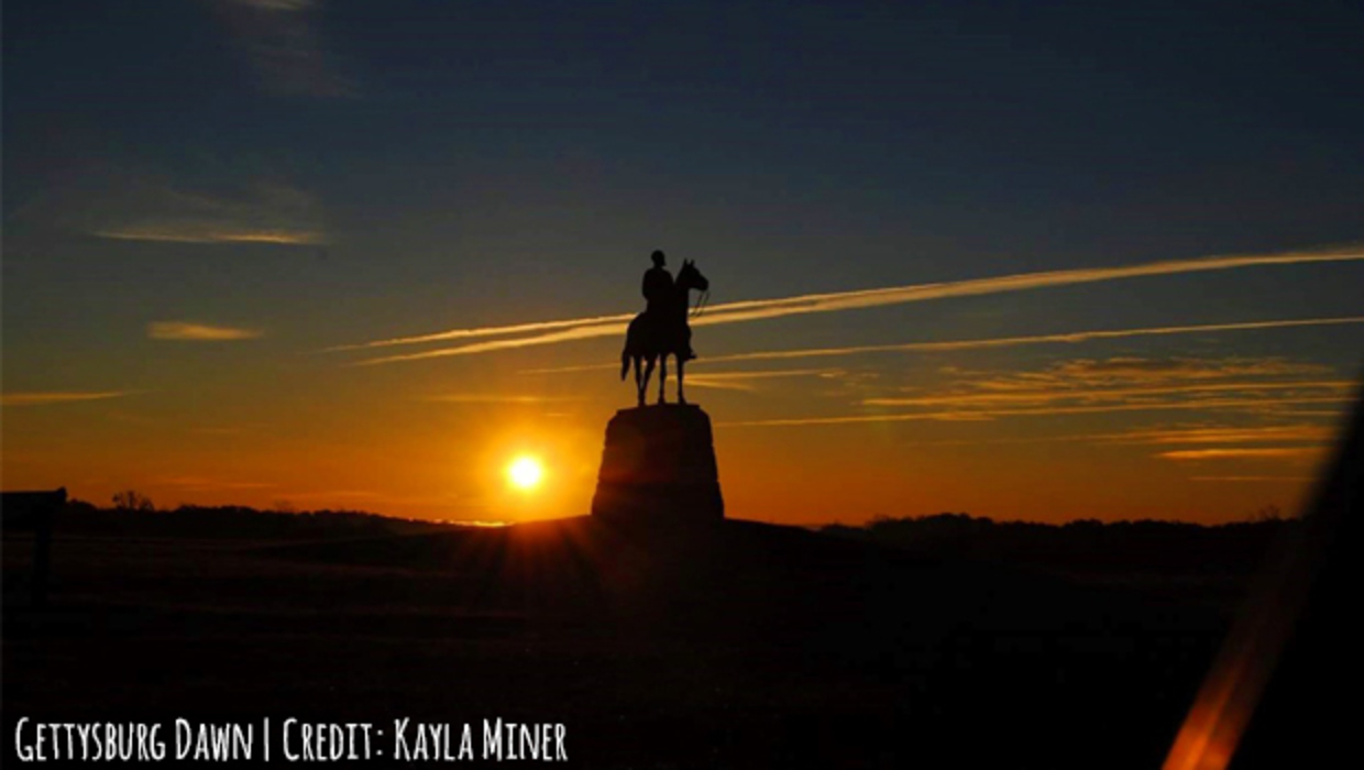 Gettysburg Dawn photograph of a silhouetted Civil War statue of a Union soldier on horseback at dawn