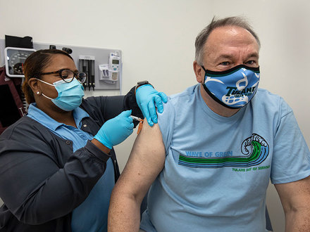 President Fitts receives flu shot from Raquel Daniels at Tulane Living Well Clinic